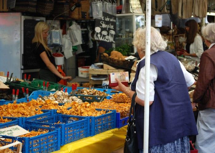 old lady mushroom picking at Viktualienmart